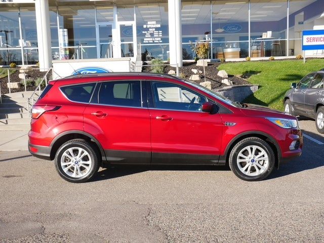 Used 2018 Ford Escape SE with VIN 1FMCU9GD0JUC70706 for sale in Minneapolis, Minnesota