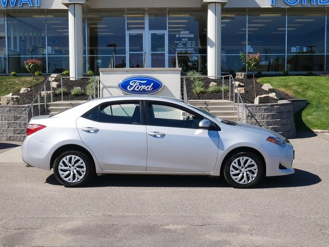 Used 2018 Toyota Corolla LE with VIN 2T1BURHE5JC996954 for sale in Minneapolis, Minnesota